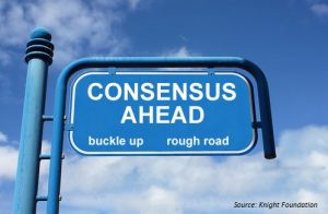A blue sign with the words consensus ahead, buckle up and rough road. Achieving consensus plays an important role when it concerns blockchaintechnology and trust. Een blauw uithangbord met de woorden consensus in aantocht, riemen vast en moeilijke weg. Het bereiken van consensus en vertrouwen speelt een belangrijke rol bij de blockchaintechologie.