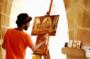 A painter doing his thing. Een kunstschilder aan het werk. Persoonlijkheidsrecht houdt in dat de naam van een kunstenaar onlosmakelijk verbonden is aan het desbetreffend werk.