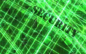 """The word """"security"""". In the background a blue chip. Security plays an important rol when it concerns smart contracts. Het Engels woord voor """"veiligheid. Veiligheid speelt een belangrijke rol als het slimme contracten betreft."""
