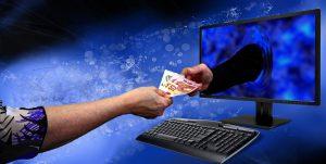 Een hand uit de pc overhandigt geld aan een Corda blockchain gebruiker.