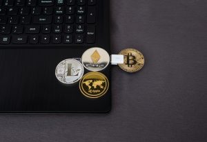 eToro, online platform, laptop, Bitcoin, Ethereum, Litecoin, Ripple