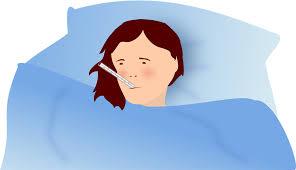 Vrouw in bed met griep.