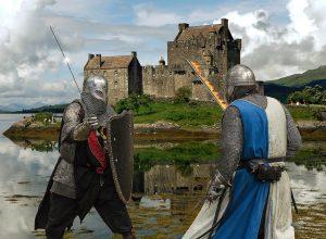 Middeleeuwse ridders in gevecht bij kasteel