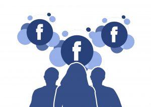 Facebook, blauw silhouette van drie mensen